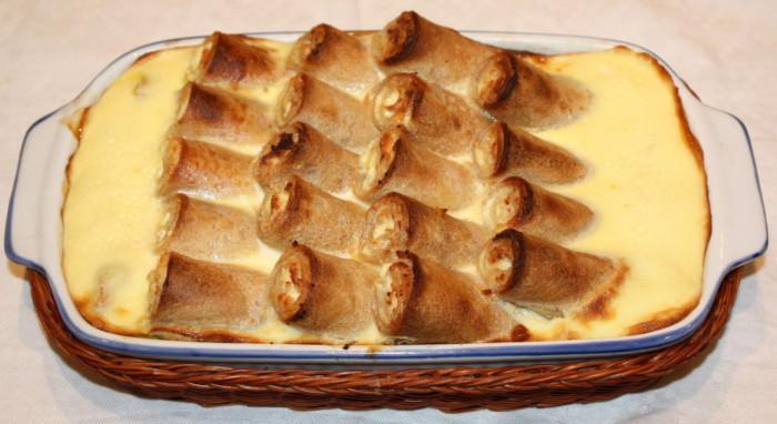 Палачінкени – налисники з сиром в духовці запечені в сметанному соусі