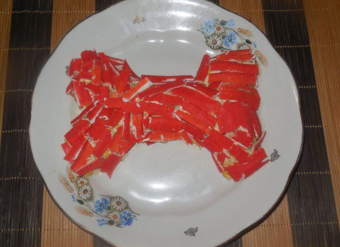 Новорічний салат Кісточка з авокадо і крабовими паличками – цікаві салати в рік Собаки